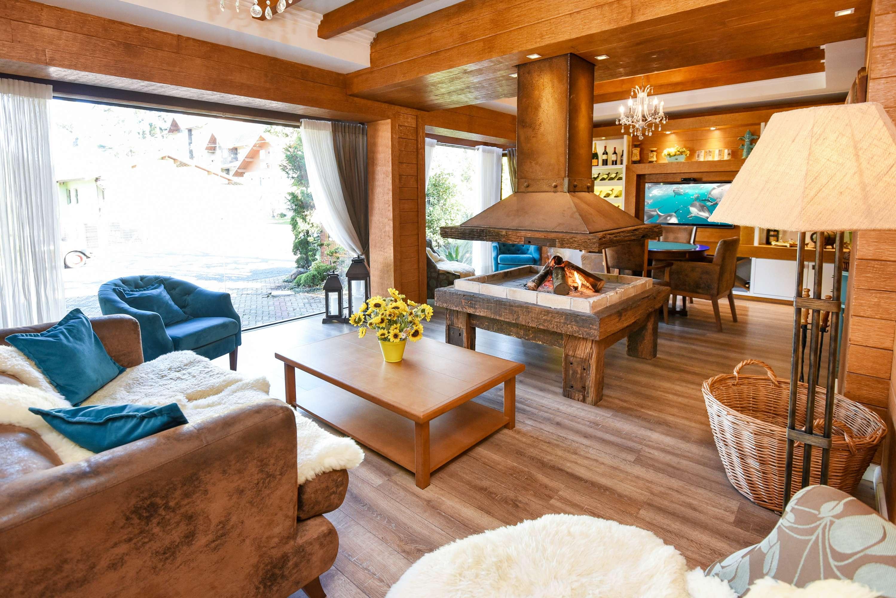 Sala Lareira Hotel Cabanas Tio Muller em Gramado