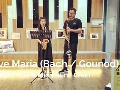 Daniel Yiau (Bass Clarinet) and Michellina Chan (Alto Saxophone)