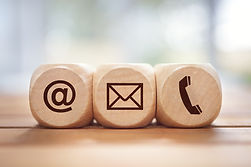 contact-us-concept-with-wood-block-and-s