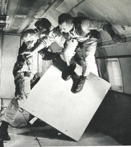 Billy Webster tests out velcro-bottomed shoes for walking on the outside of a spacecraft.