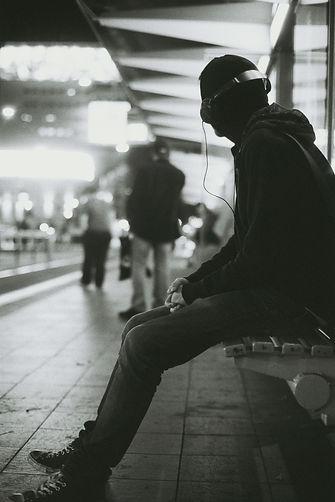 Man sitting alone by Max Wolfs on Unsplash