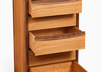 The drawers are made from maple with cedar drawer bottoms.