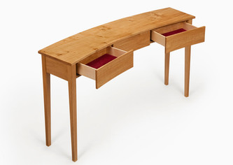 The drawers are made from maple and lined with a burgundy colour suede.