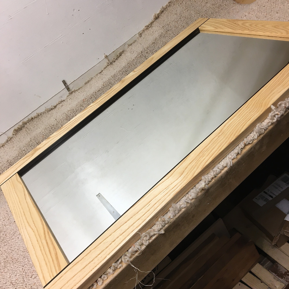 Bespoke wall mirror made from ash and fumed oak