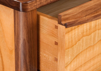 Dovetail joints are used on the drawer construction.