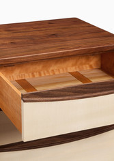 The drawer bottoms are cedar, a timber traditionally used for drawer bottoms.