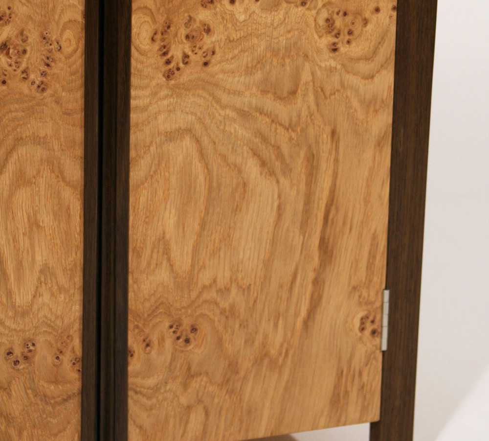 Cabinet made from oak cluster and fumed oak.