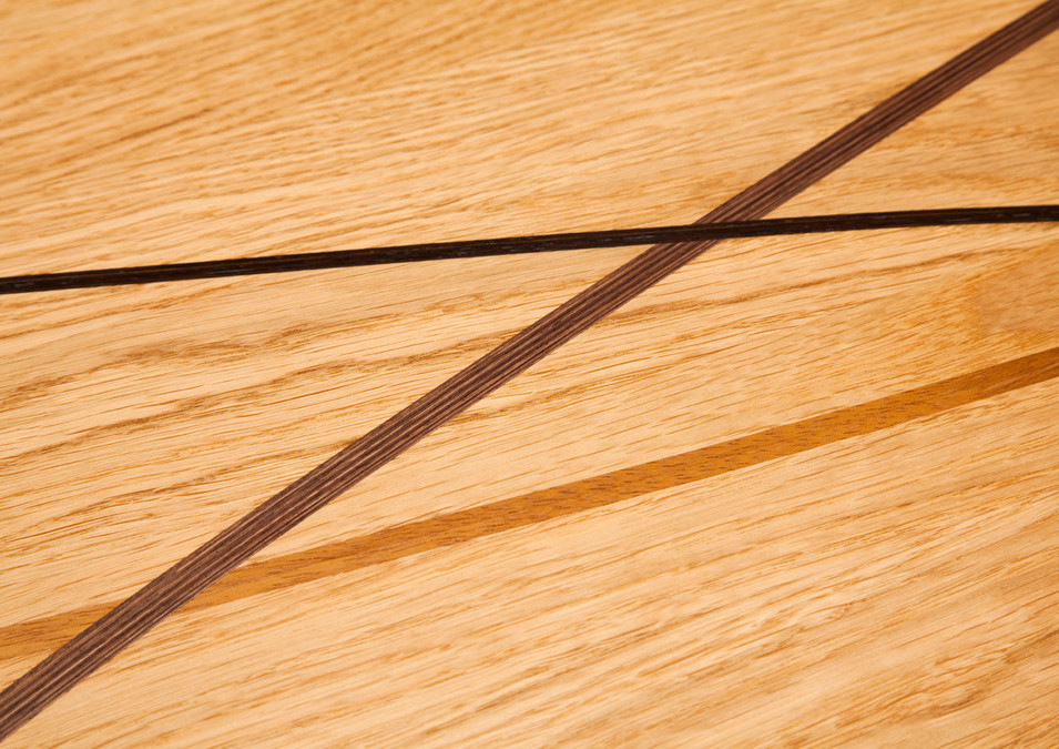 Close-up of solid wood inlays on the oak coffee table