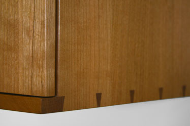 The cabinet uses dovetail joints in the carcass construction.