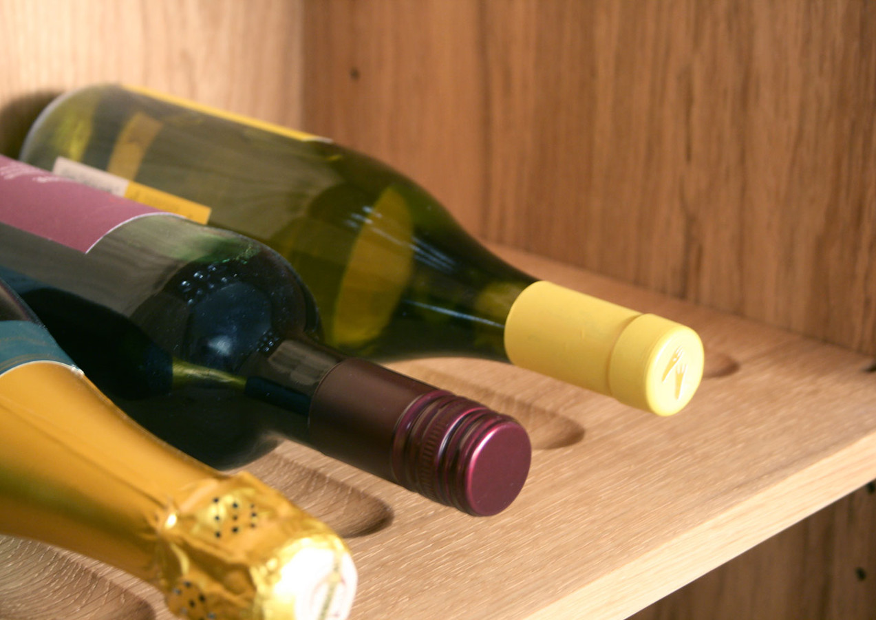 Wine bottles lay down in special recesses.