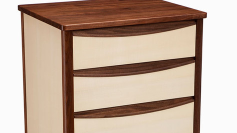 Sycamore and walnut chest of drawers