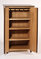 Inside the cabinet are four adjustable shelves, one of the shelves made to hang wine glasses from.