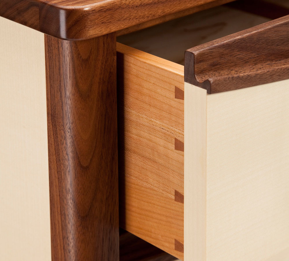 Drawers are made with dovetail construction.