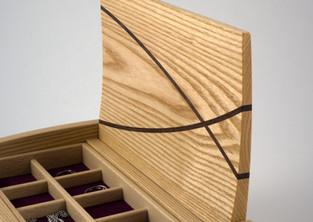 Curved lidded ash jewellery box