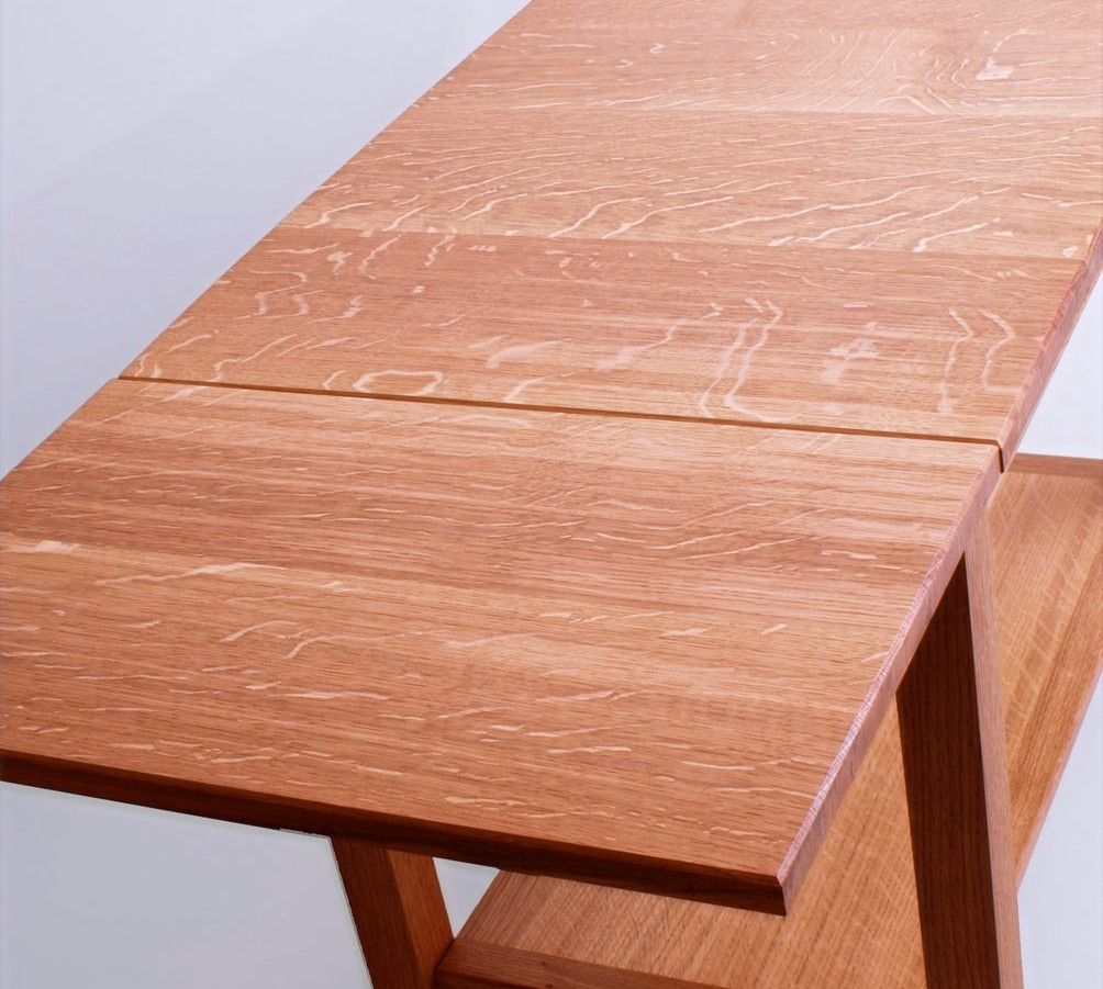 Quarter sawn oak is used for the table top.