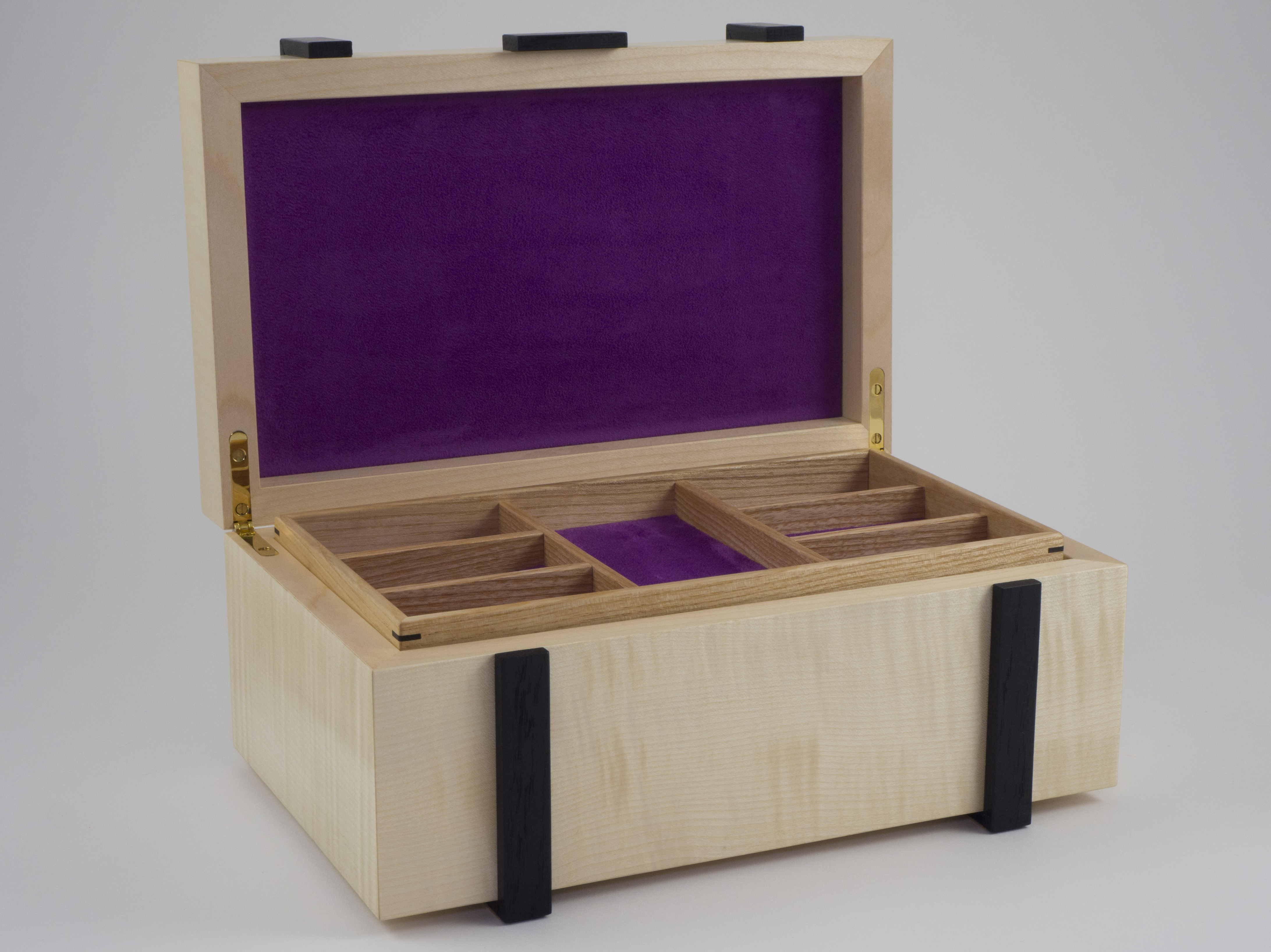 Jewellery box open, showing top tray