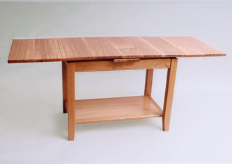 Two leaves of the table can be pulled out if rquired.
