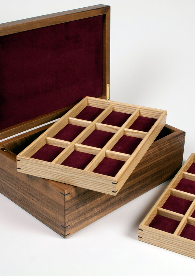 Jewellery box with storage trays