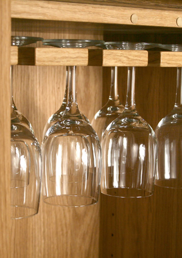 Wine glasses hanging from the shelf.