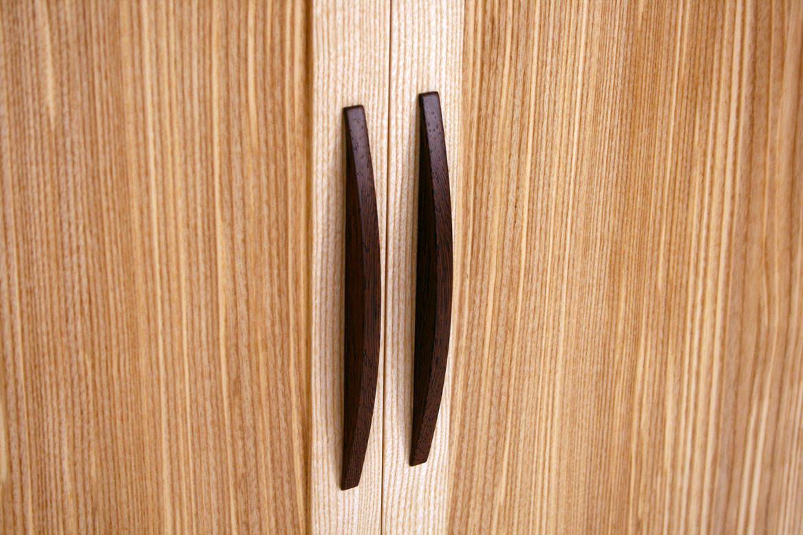 Close-up shot of wenge handles on the olive ash sideboard.