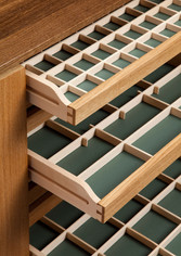 The drawers are lined with a green leather