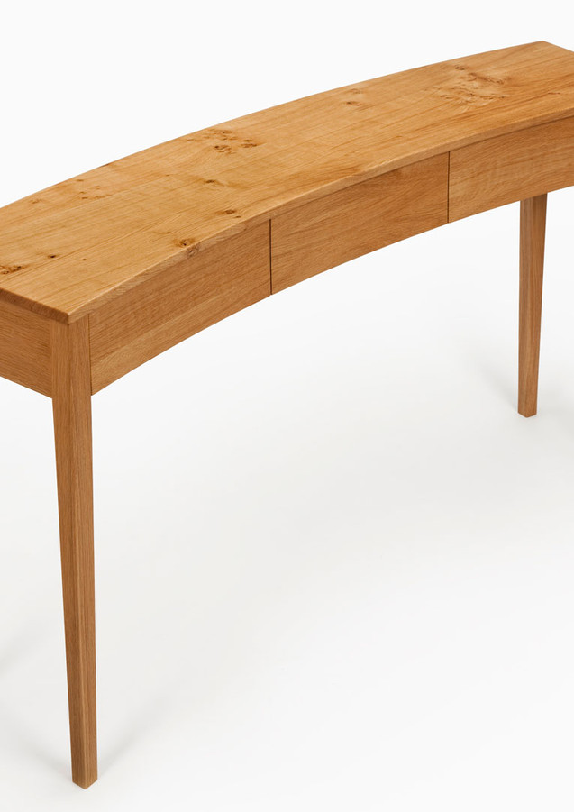 Curved console table made from oak.
