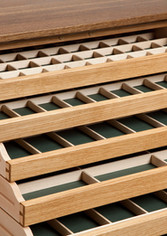 Each drawer is divided into a number of compartments