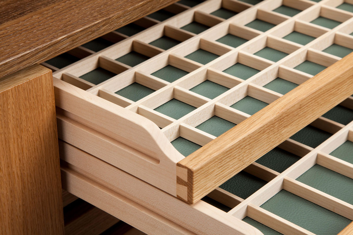 The drawers use dovetail joints in their construction.