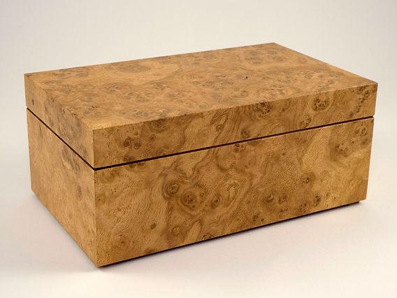 Bespoke made jewellery box in oak burr wood