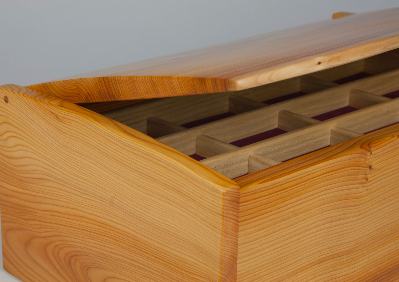 Jewellery box with curved lid
