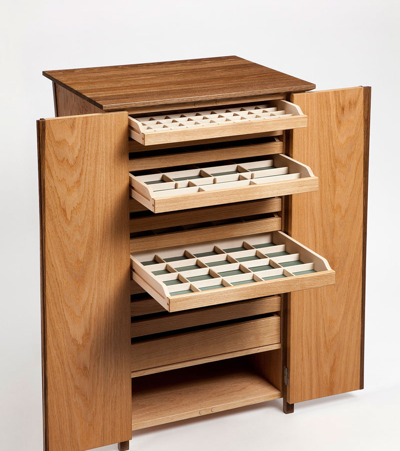 Inside the cabinet are twelve drawers