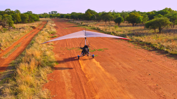 microlight landing|bush veld|flying in big 5