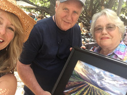 selfie of Tim and Cathy with the artist Diane and - Coming and Going cane to sunflowers