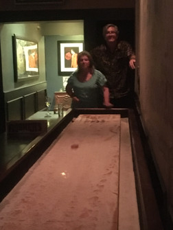 Table shuffleboard with friends