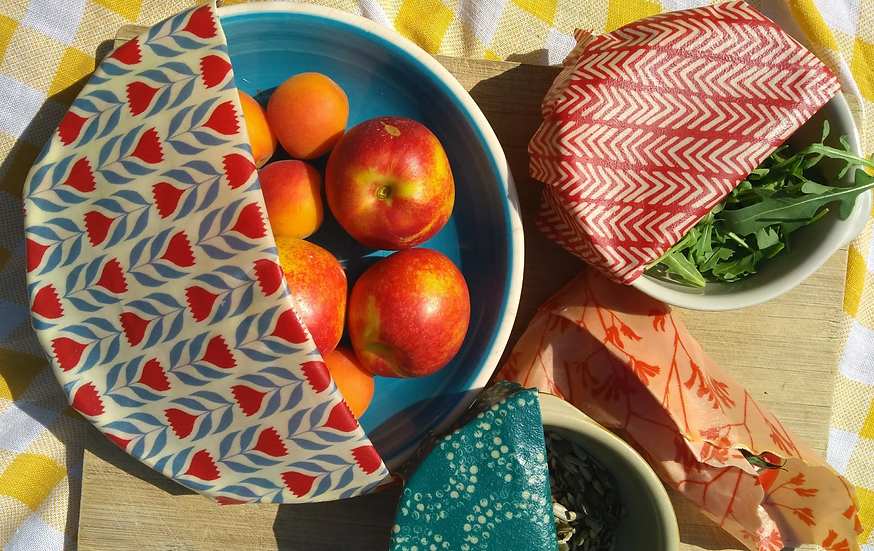 beeswax wraps in use covering food at a picnic
