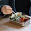 person eating lunch out of slimline reusable metal lunch box