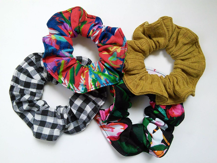 a collection of handmade eco-friendly scrunchies made using upcycled materials