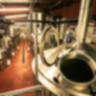 This shows an overview of the many enormous tanks used in the brewing process.
