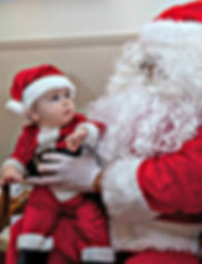 A youngster meets Santa Claus during Breakfast with Santa.