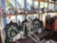 Dept. 56 Halloween houses and characters surround a skeleton on the porch of the Physick House