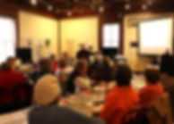People listen to a speaker at Lunch & Learn