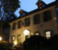 The historic, Federal-style Cherry House on Hughes Street is shown on night, waiting for visitors to take a tour and hear about its ghistly residents