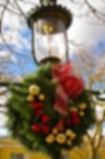 One of Cape May's charming gaslit street lights is decked out for Christmas.