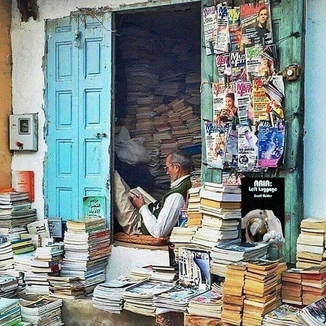 Indian bookshop owner reading.