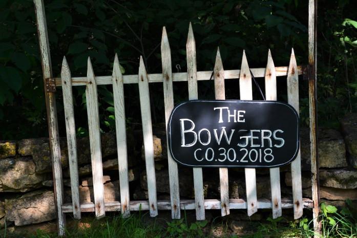 sign on picket fence