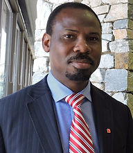 Photo of Jide Kupoluyi, Calgary real estate lawyer, Calgary business lawyer, Calgary immigration lawyer, Calgary wills and estate lawyer and Notary Public and Commissioner for Oaths