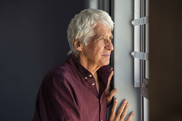 lonely-old-man-looking-out-the-window-U3