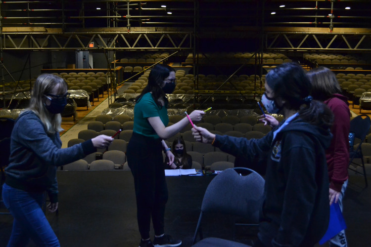 Catherine watches as Kylie, Raiah, Maya and Aly rehearse the opening scene