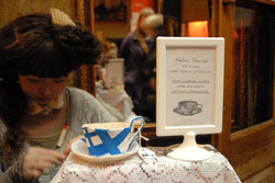 Hand sewing behind stall