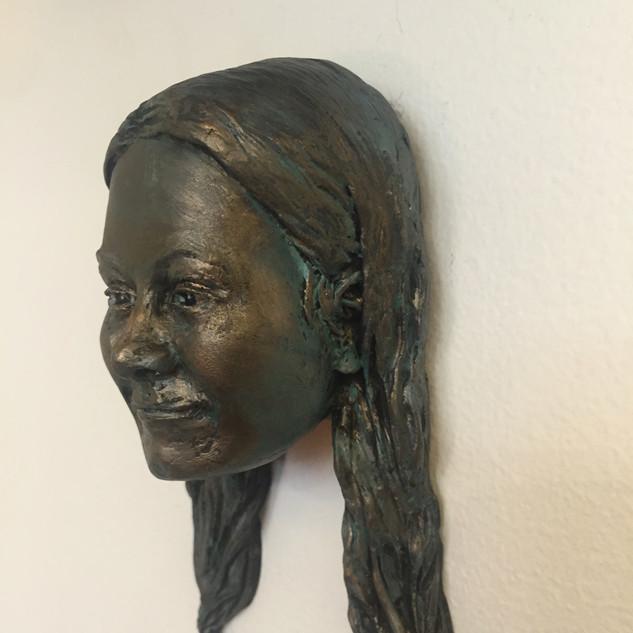 poly portrait bronze finish 1